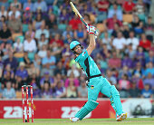 Daniel Christian of the Heat hits a six during the Big Bash League match between the Hobart Hurricanes and the Brisbane Heat at Blundstone Arena on...