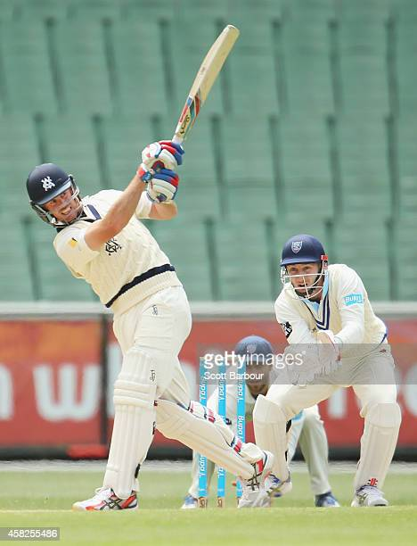 Daniel Christian of Victoria bats as wicketkeeper Peter Nevill of New South Wales looks on during day three of the Sheffield Shield match between...