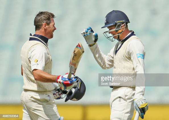 Daniel Christian of Victoria is congratulated by Peter Handscomb after he reached his century during day three of the Sheffield Shield match between...