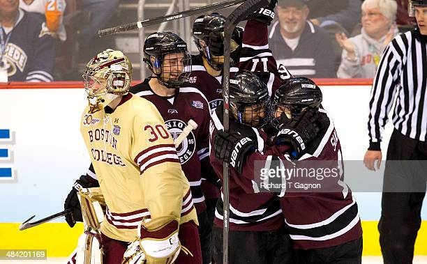 Daniel Ciampini of the Union College Dutchmen celebrates his third goal of the game with teammate Kevin Sullivan during the NCAA Division I Men's Ice...