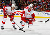 Daniel Cleary and Danny Dekeyser of the Detroit Red Wings line up to face off against the Calgary Flames at Scotiabank Saddledome on January 7 2015...
