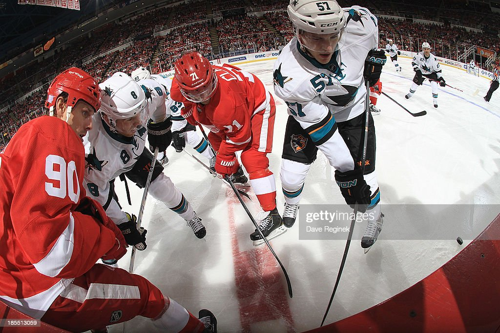 <a gi-track='captionPersonalityLinkClicked' href=/galleries/search?phrase=Daniel+Cleary&family=editorial&specificpeople=220490 ng-click='$event.stopPropagation()'>Daniel Cleary</a> #71 and Stephen Weiss #90 of the Detroit Red Wings battle for the puck along the boards with <a gi-track='captionPersonalityLinkClicked' href=/galleries/search?phrase=Tommy+Wingels&family=editorial&specificpeople=5807738 ng-click='$event.stopPropagation()'>Tommy Wingels</a> #57 and <a gi-track='captionPersonalityLinkClicked' href=/galleries/search?phrase=Joe+Pavelski&family=editorial&specificpeople=687042 ng-click='$event.stopPropagation()'>Joe Pavelski</a> #8 of the San Jose Sharks during an NHL game at Joe Louis Arena on October 21, 2013 in Detroit, Michigan.