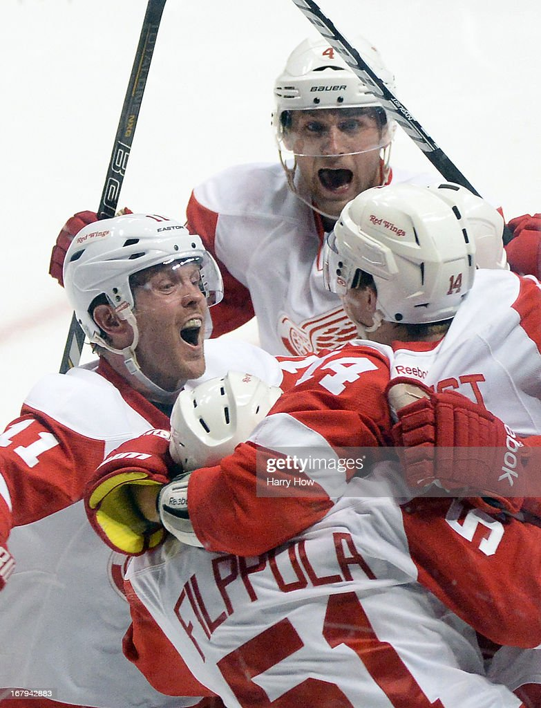 Daniel Cleary #11, Jakub Kindl #4, and Jonathan Ericsson #52 celebrates the goal of Gustav Nyquist #14 of the Detroit Red Wings to give the the Red Wings a 5-4 overtime win in Game Two of the Western Conference Quarterfinals during the 2013 Stanley Cup Playoffs at Honda Center on May 2, 2013 in Anaheim, California.