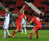 Daniel Cleary of Liverpool celebrates his goal with team mate Tom Brewitt during the UEFA Youth League fixture between Liverpool and FC Basel at...