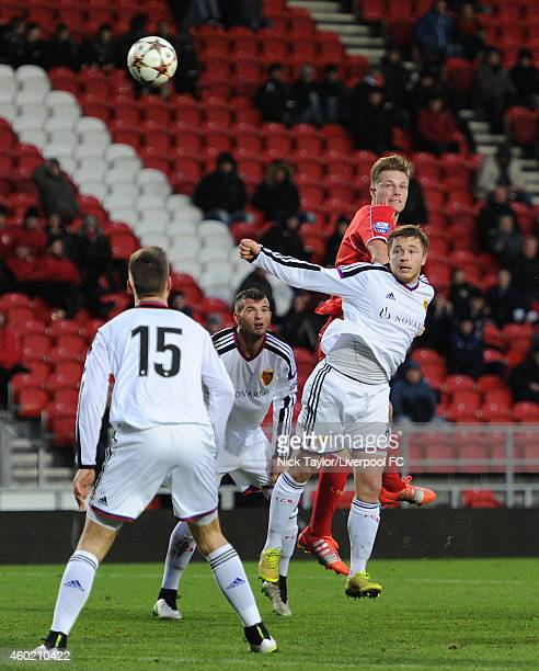 Daniel Cleary of Liverpool guides a headed shot goal bound during the UEFA Youth League fixture between Liverpool and FC Basel at Langtree Park on...