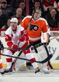Daniel Cleary of the Detroit Red Wings attempts to screen goaltender Steve Mason of the Philadelphia Flyers on January 28 2014 at the Wells Fargo...