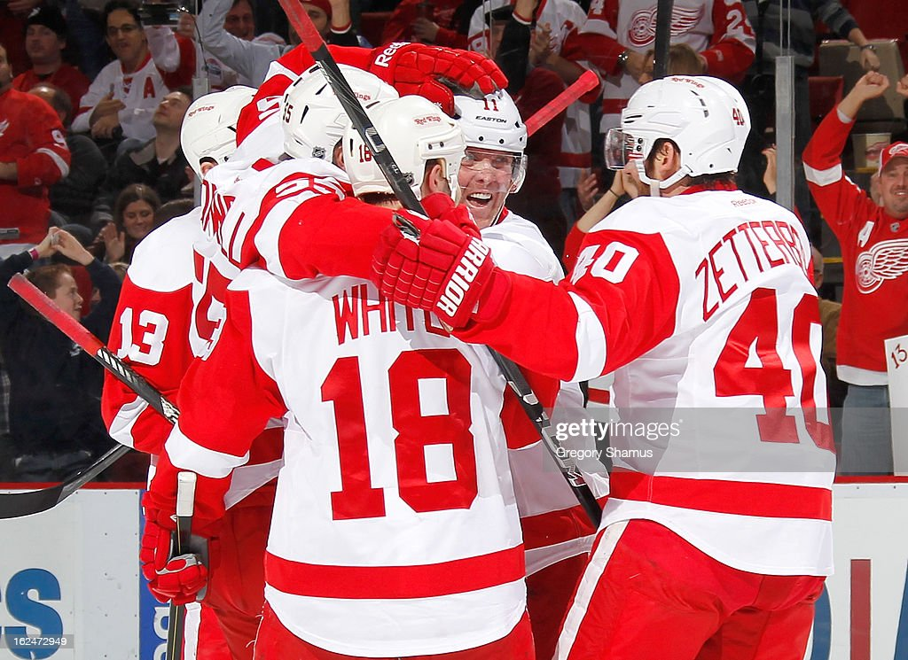 Daniel Cleary #11 of the Detroit Red Wings celebrates his third period goal with Henrik Zetterberg #40 and Ian White #18 while playing the Nashville Predators at Joe Louis Arena on February 23, 2013 in Detroit, Michigan. Detroit won the game 4-0.