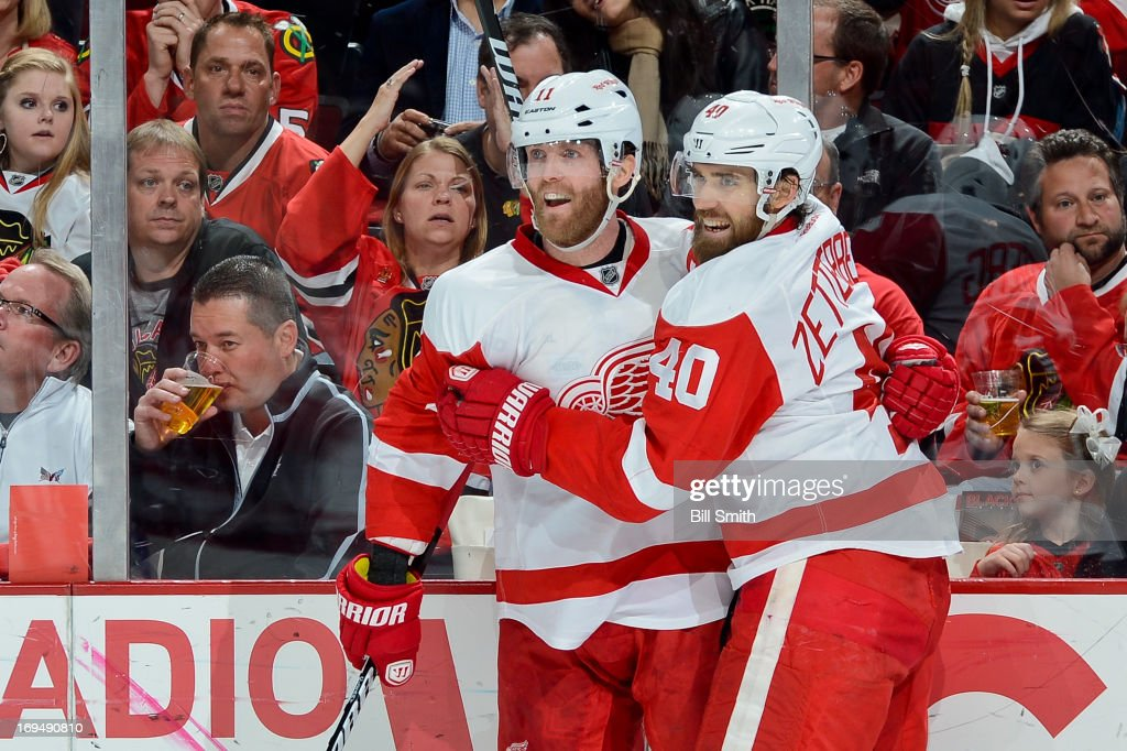 <a gi-track='captionPersonalityLinkClicked' href=/galleries/search?phrase=Daniel+Cleary&family=editorial&specificpeople=220490 ng-click='$event.stopPropagation()'>Daniel Cleary</a> #11 of the Detroit Red Wings celebrates with teammate <a gi-track='captionPersonalityLinkClicked' href=/galleries/search?phrase=Henrik+Zetterberg&family=editorial&specificpeople=201520 ng-click='$event.stopPropagation()'>Henrik Zetterberg</a> #40 after scoring against the Chicago Blackhawks in the second period in Game Five of the Western Conference Semifinals during the 2013 Stanley Cup Playoffs at the United Center on May 25, 2013 in Chicago, Illinois.
