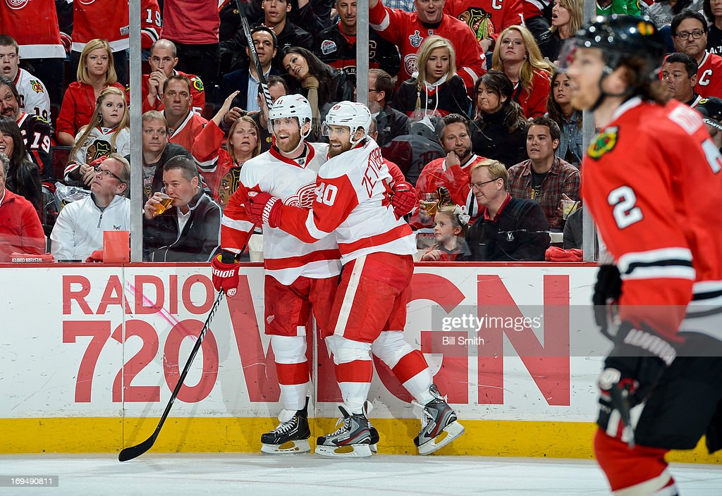 Daniel Cleary #11 of the Detroit Red Wings celebrates with teammate Henrik Zetterberg #40 after scoring against the Chicago Blackhawks in the second period, as Duncan Keith #2 of the Blackhawks skates in the foreground, in Game Five of the Western Conference Semifinals during the 2013 Stanley Cup Playoffs at the United Center on May 25, 2013 in Chicago, Illinois.