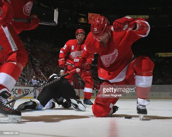 Daniel Cleary of the Detroit Red Wings controls the puck in front of teammate Niklas Kronwall during Game Four of the Western Conference...