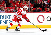 Daniel Cleary of the Detroit Red Wings controls the puck on the ice during their NHL game against the Carolina Hurricanes at PNC Arena on December 7...