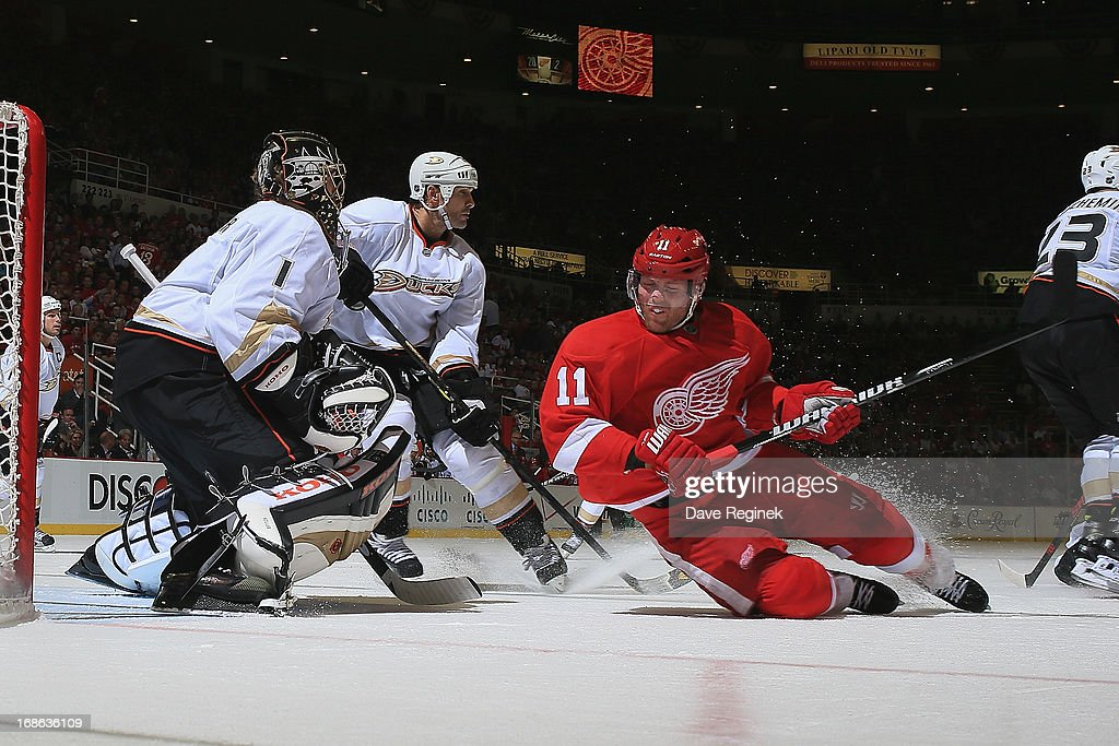 Daniel Cleary of the Detroit Red Wings dives out of the way of a shot in front of Jonas Hiller and Sheldon Souray of the Anaheim Ducks during Game...