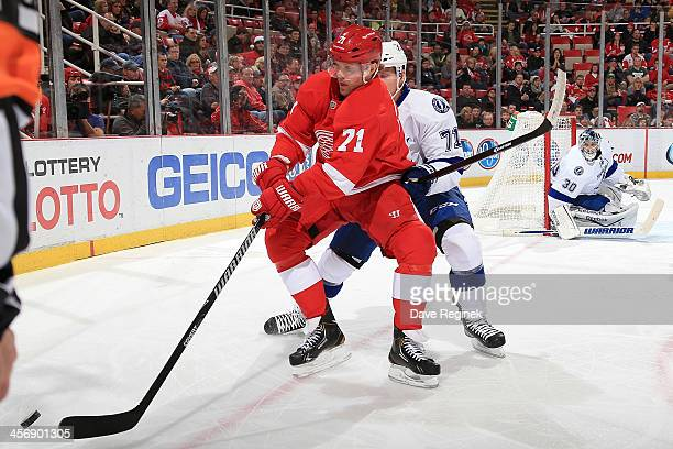 Daniel Cleary of the Detroit Red Wings handles the puck in the corner while Richard Panik of the Tampa Bay Lightning defends him during an NHL game...