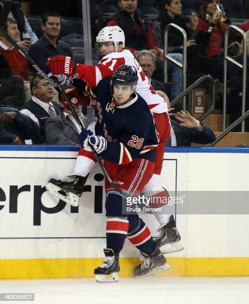 Daniel Cleary of the Detroit Red Wings is hit into the boards by Chris Kreider of the New York Rangers during the first period at Madison Square...