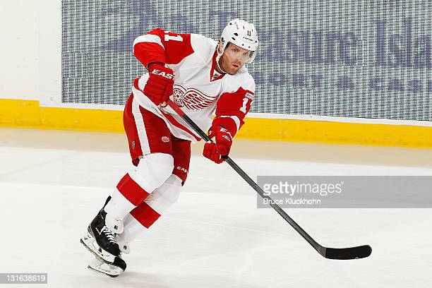 Daniel Cleary of the Detroit Red Wings passes the puck against the Minnesota Wild during the game at the Xcel Energy Center on October 29 2011 in...