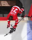 Daniel Cleary of the Detroit Red Wings pushes all the pucks to the ice for warmups before an NHL game against the Ottawa Senators at Joe Louis Arena...
