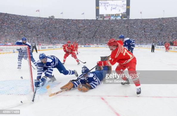 Daniel Cleary of the Detroit Red Wings puts the puck through the crease area on his centering attempt past Carl Gunnarsson and goaltender Jonathan...