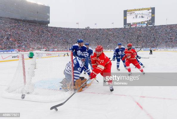 Daniel Cleary of the Detroit Red Wings shoots against Jonathan Bernier of the Toronto Maple Leafs in the second period during the 2014 Bridgestone...