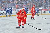 Daniel Cleary of the Detroit Red Wings shoots the puck during warmup prior to the 2014 Bridgestone NHL Winter Classic on January 1 2014 at Michigan...