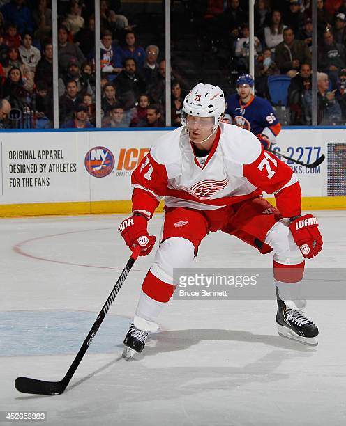 Daniel Cleary of the Detroit Red Wings skates against the New York Islanders at the Nassau Veterans Memorial Coliseum on November 29 2013 in...