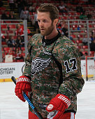 Daniel Cleary of the Detroit Red Wings skates around in warmups while wearing his 'Camo' jersey in honor of the servicemen and women as part of...