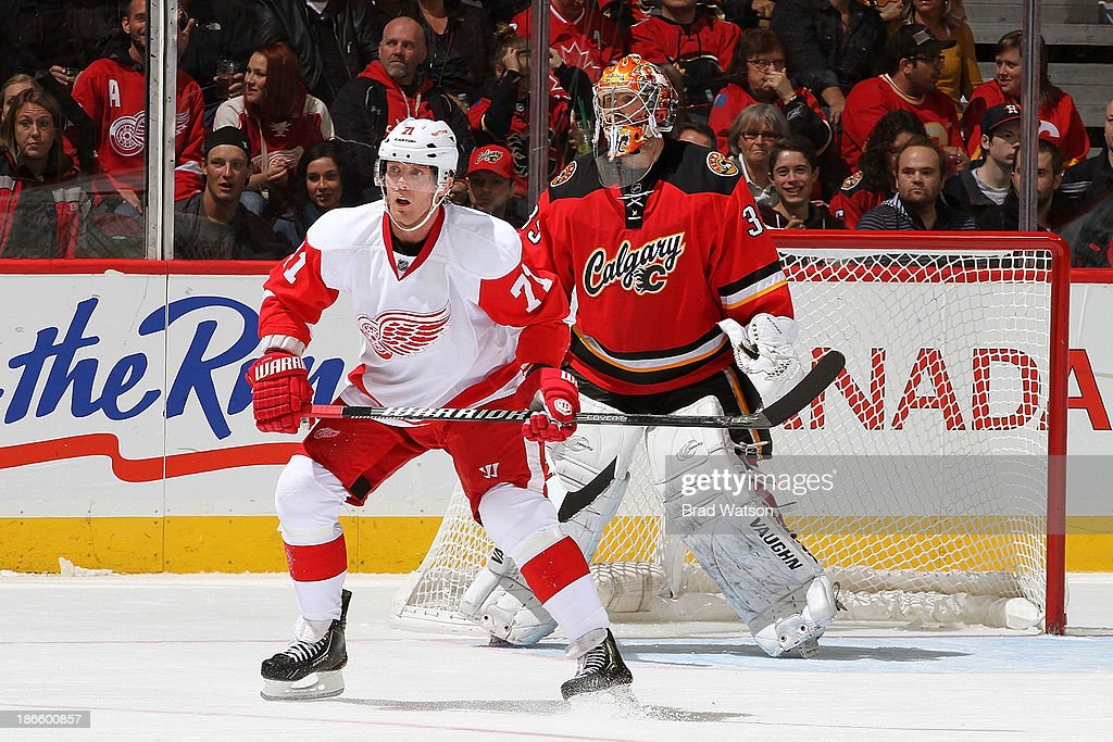 <a gi-track='captionPersonalityLinkClicked' href=/galleries/search?phrase=Daniel+Cleary&family=editorial&specificpeople=220490 ng-click='$event.stopPropagation()'>Daniel Cleary</a> #71 of the Detroit Red Wings skates in front of <a gi-track='captionPersonalityLinkClicked' href=/galleries/search?phrase=Joey+MacDonald&family=editorial&specificpeople=2234367 ng-click='$event.stopPropagation()'>Joey MacDonald</a> #35 of the Calgary Flames at Scotiabank Saddledome on November 1, 2013 in Calgary, Alberta, Canada.