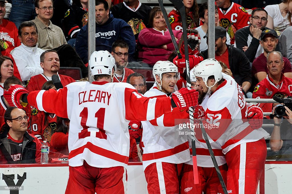 Daniel Cleary #11 of the Detroit Red Wings skates in to celebrate with teammates Valtteri Filppula #51, Henrik Zetterberg #40 and Jonathan Ericsson #52 after Filppula scored in the third period against the Chicago Blackhawks in Game Two of the Western Conference Semifinals during the 2013 Stanley Cup Playoffs at the United Center on May 18, 2013 in Chicago, Illinois.