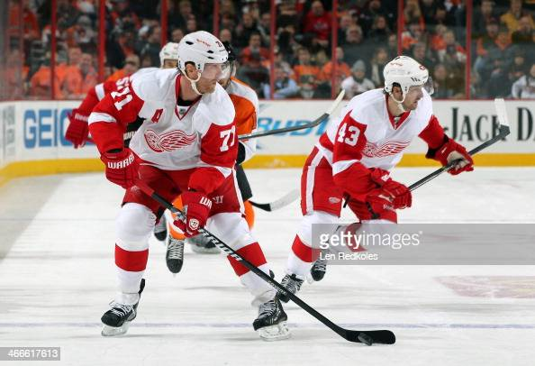 Daniel Cleary of the Detroit Red Wings skates the puck with Darren Helm against the Philadelphia Flyers on January 28 2014 at the Wells Fargo Center...