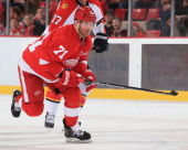 Daniel Cleary of the Detroit Red Wings skates up ice against the Florida Panthers during an NHL game on January 26 2014 at Joe Louis Arena in Detroit...