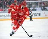 Daniel Cleary of the Detroit Red Wings skates up ice with the puck against the Toronto Maple Leafs during the Bridgestone NHL Winter Classic on...
