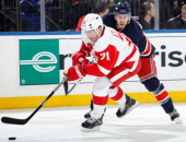 Daniel Cleary of the Detroit Red Wings skates with the puck against the New York Rangers at Madison Square Garden on January 16 2014 in New York City...