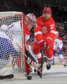 Daniel Cleary of the Detroit Red Wings stretches for the puck at the side of the net as goalie Carey Price of the Montreal Canadiens covers the post...