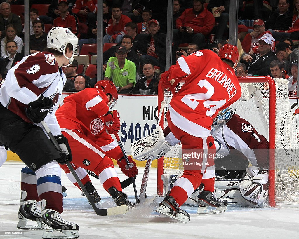 Daniel Cleary #11 of the Detroit Red Wings tips the puck past Semyon Varlamov #1 of the Colorado Avalanche scoring a goal during a NHL game at Joe Louis Arena on April 1, 2013 in Detroit, Michigan.