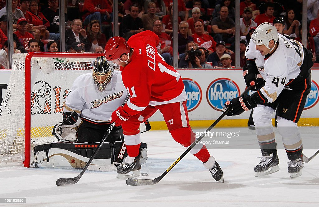 Daniel Cleary of the Detroit Red Wings tries to get a shot off between Jonas Hiller and Sheldon Souray of the Anaheim Ducks during the second period...