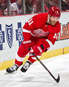 Daniel Cleary of the Detroit Red Wings turns up ice against the Columbus Blue Jackets during a NHL game on December 16 2014 at Joe Louis Arena in...