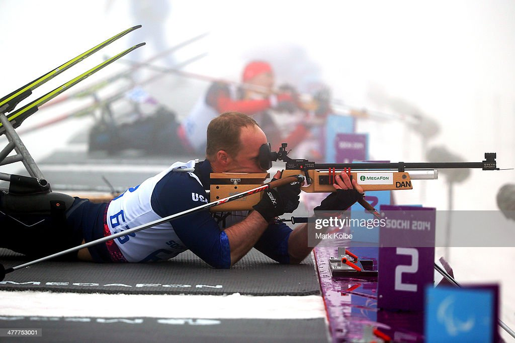 Daniel Cnossen of USA competes in the Men's Biathlon 125km Sitting during day four of Sochi 2014 Paralympic Winter Games at Laura Crosscountry Ski...