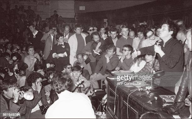 CHARLTON Daniel CohnBendit leader of the Sorbonne occupation listens as an unidentified man addresses a crowd on June 2 1968 in Paris Four decades on...