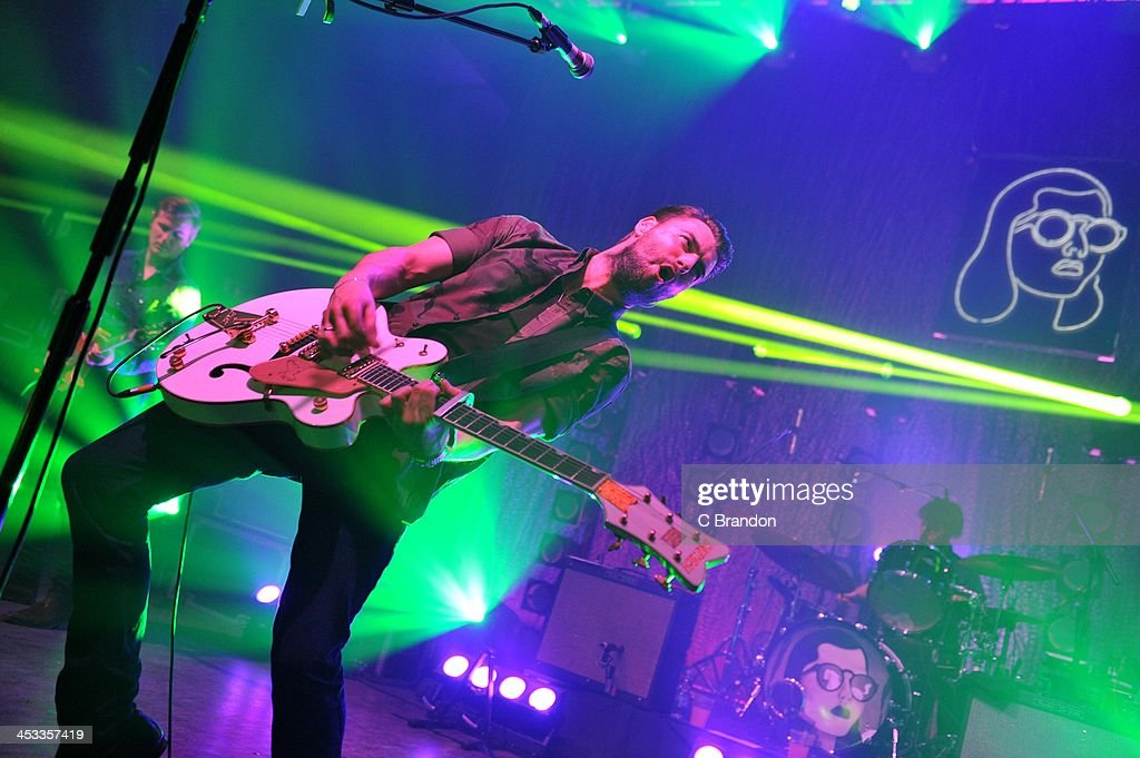 Daniel 'Conan' Moores Liam Fray and Michael Campbell of The Courteeners perform on stage at Shepherds Bush Empire on December 3 2013 in London United...