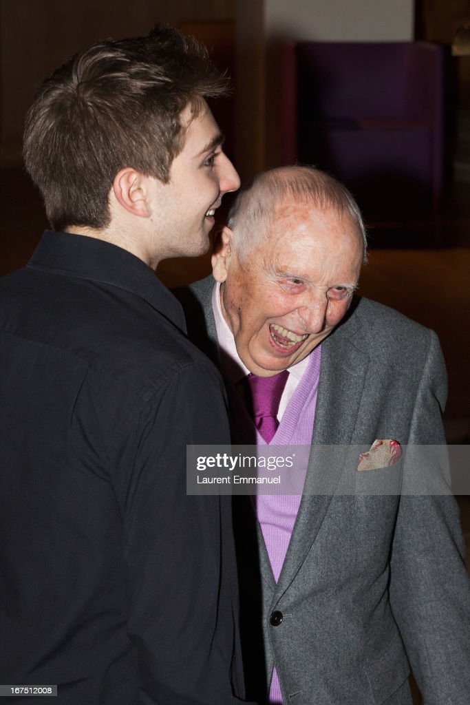 Daniel Cordier (R) and actor Jules Sadoughi share a light moment as they attend 'Alias Caracalla' Paris Premiere at Cinema l'Arlequin on April 25, 2013 in Paris, France.