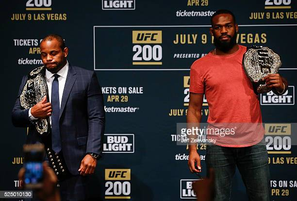 Daniel Cormier and Jon Jones pose for a photo after squaring off during a media availability for UFC 200 at Madison Square Garden on April 27 2016 in...