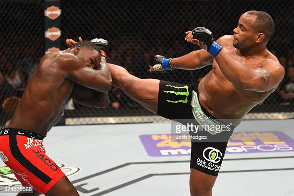 Daniel Cormier kicks Anthony Johnson in their UFC light heavyweight championship bout during the UFC 187 event at the MGM Grand Garden Arena on May...