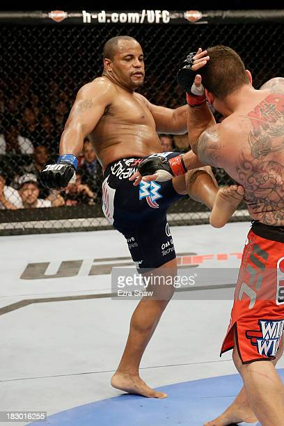 Daniel Cormier kicks Frank Mir in their heavyweight bout during the UFC on FOX event at the HP Pavilion on April 20 2013 in San Jose California