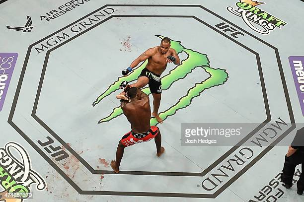 Daniel Cormier lands a kick to the head of Anthony 'Rumble' Johnson in their UFC light heavyweight championship bout during the UFC 187 event at the...