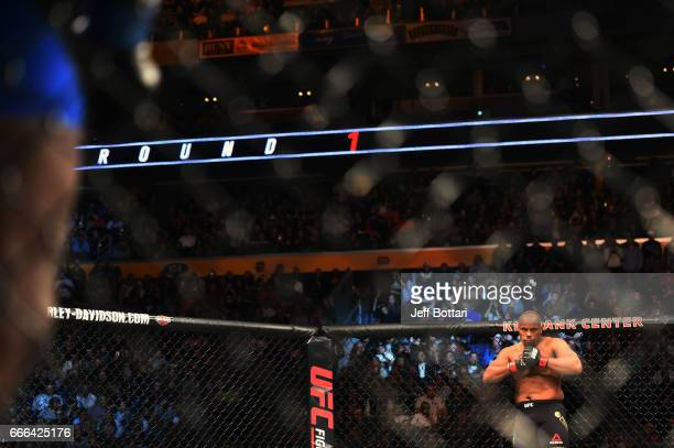 Daniel Cormier looks across the Octagon as his opponent Anthony Johnson prior to their UFC light heavyweight championship bout during the UFC 210...