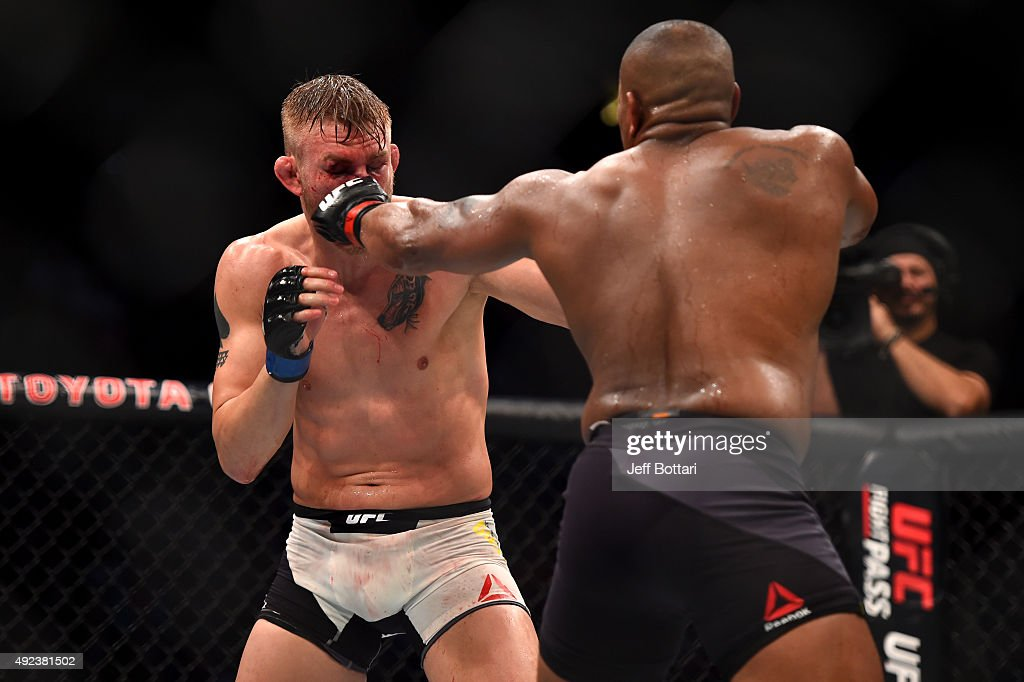Daniel Cormier punches Alexander Gustafsson in their UFC light heavyweight championship bout during the UFC 192 event at the Toyota Center on October 3, 2015 in Houston, Texas.