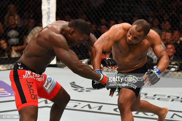 Daniel Cormier punches Anthony Johnson in their UFC light heavyweight championship bout during the UFC 187 event at the MGM Grand Garden Arena on May...