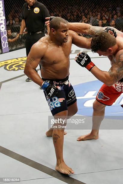 Daniel Cormier punches Frank Mir in their heavyweight bout during the UFC on FOX event at the HP Pavilion on April 20 2013 in San Jose California