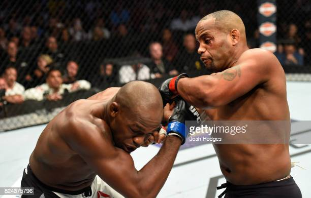 Daniel Cormier punches Jon Jones in their UFC welterweight championship bout during the UFC 214 event at Honda Center on July 29 2017 in Anaheim...