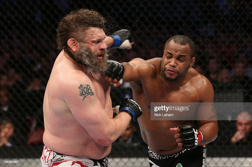 <a gi-track='captionPersonalityLinkClicked' href=/galleries/search?phrase=Daniel+Cormier&family=editorial&specificpeople=171300 ng-click='$event.stopPropagation()'>Daniel Cormier</a> punches Roy 'Big Country' Nelson in their UFC heavyweight bout at the Toyota Center on October 19, 2013 in Houston, Texas.