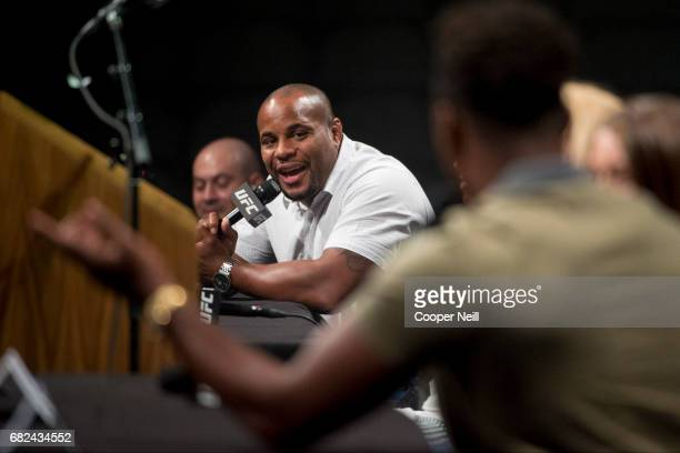 Daniel Cormier speaks to Jon Jones during the UFC Summer Kickoff Press Conference at the American Airlines Center on May 12 2017 in Dallas Texas